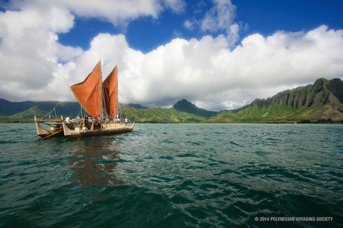 The day breaks over Hōkūleʻa with Kualoa behind her.